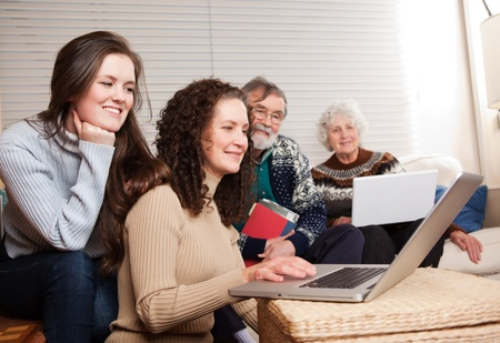 A shot of a family spending time at home with laptop Stock Photo - 8809412