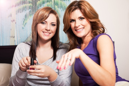A shot of a mother spending time with her teenage daughter photo