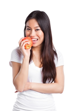 An isolated shot of a beautiful asian woman eating an apple