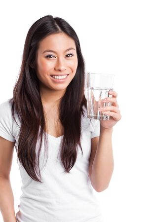 An isolated shot of a beautiful asian woman holding a glass of water Archivio Fotografico