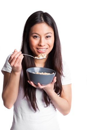 An isolated shot of an asian woman holding a bowl of cereal