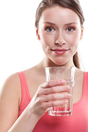 An isolated shot of a beautiful caucasian woman drinking water Stock Photo - 8809992