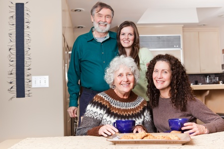 mature old generation: A multi generation portrait of happy grandparents with their daughter and granddaughter spending time together
