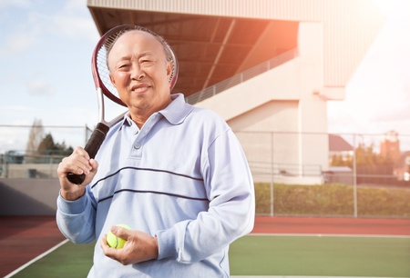 playing tennis: A shot of a senior asian man playing tennis