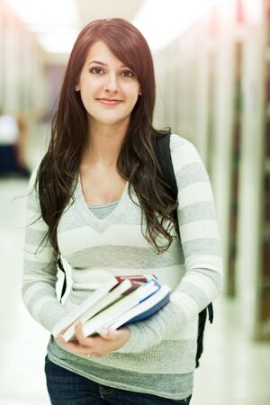 college: A portrait of a mixed race college student at campus Stock Photo
