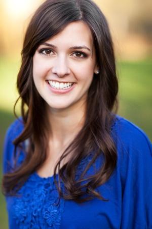 headshot: A portrait of a smiling beautiful woman