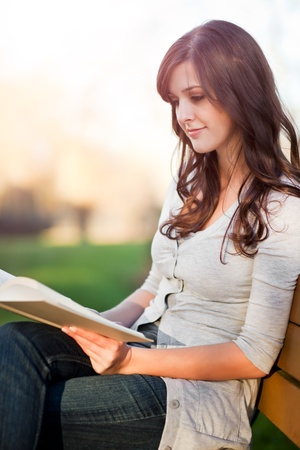 student reading: A shot of a college student reading a book Stock Photo