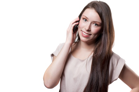 An isolated shot of a beautiful caucasian businesswoman talking on the phone Stock Photo - 9075760