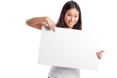 placard: An isolated shot of a beautiful asian woman holding a blank poster
