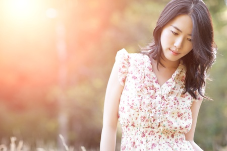 A portrait of a beautiful asian woman outdoor Stock Photo - 9154645