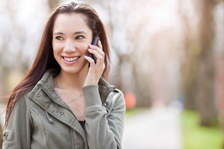 A shot of an ethnic student talking on the phone Stock Photo - 9154727
