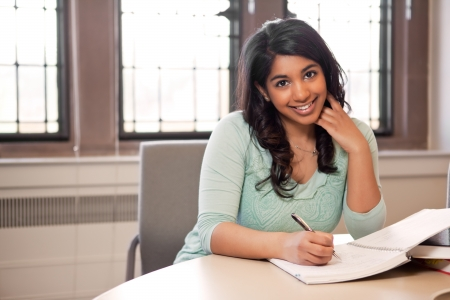 college campus: A shot of an asian student studying in a library Stock Photo