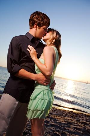 A romantic caucasian couple in love on the beach photo