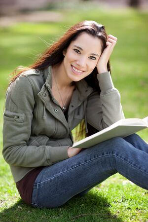 A shot of an ethnic college student studying on campus Stock Photo - 9249166