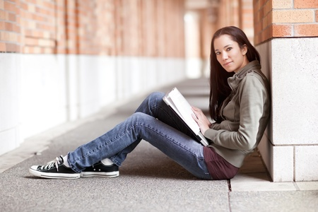 A shot of an ethnic college student studying on campus photo