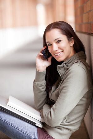 A shot of an ethnic student talking on the phone photo