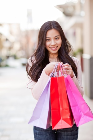 A shot of an asian woman shopping outdoor photo