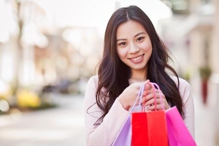 A shot of an asian woman shopping outdoor Stock Photo - 9249142
