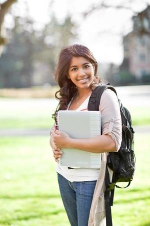 キャンパス内に満足アジア学生の肖像画 写真素材