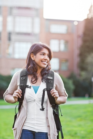 indian youth: A portrait of a happy asian student on campus