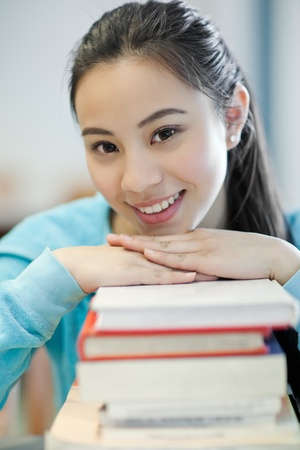 A portrait of an Asian college student studying in the library Stock Photo - 9285567