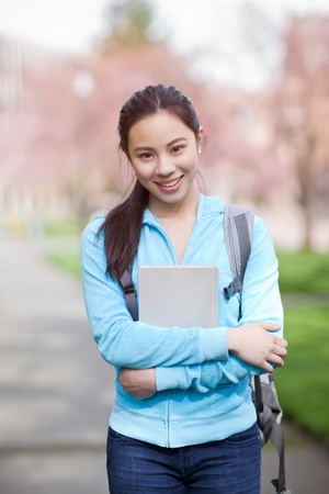 A shot of an Asian college student on campus Stock Photo