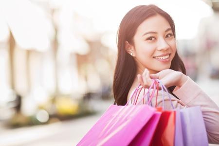 A shot of an asian woman shopping outdoor Stock Photo