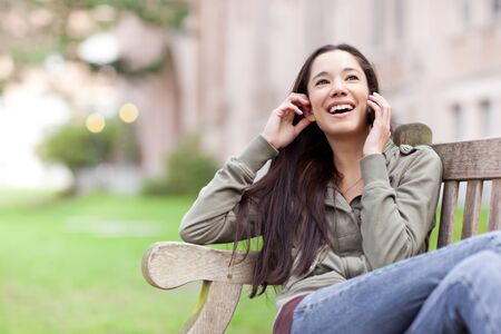 A shot of an ethnic student talking on the phone Stock Photo - 9455979