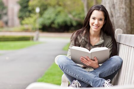 native american: A shot of an ethnic college student studying on campus Stock Photo