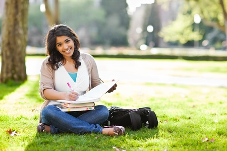A shot of an asian student studying on campus lawn Stock Photo - 9457558
