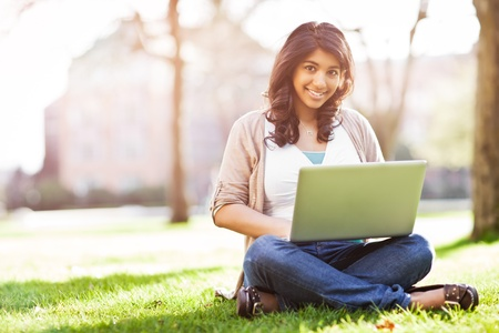 asian laptop: A shot of an asian student using laptop on campus