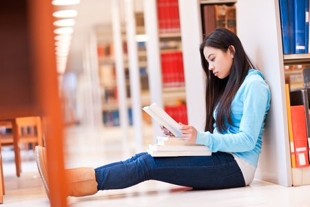 A portrait of an Asian college student studying in the library photo