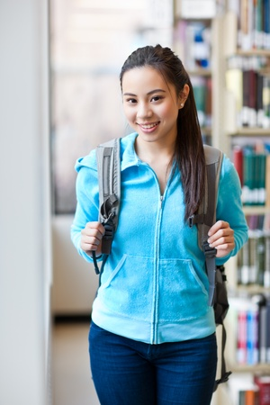 A portrait of an Asian college student studying in the library Stock Photo - 9518980