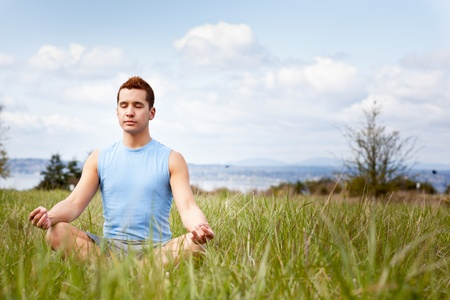 A shot of a mixed race man practicing yoga outdoor