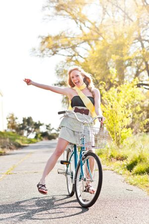A portrait of a beautiful young Caucasian woman riding her bike outdoor photo
