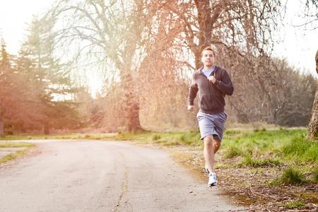 intense: A shot of a mixed race man running outdoor