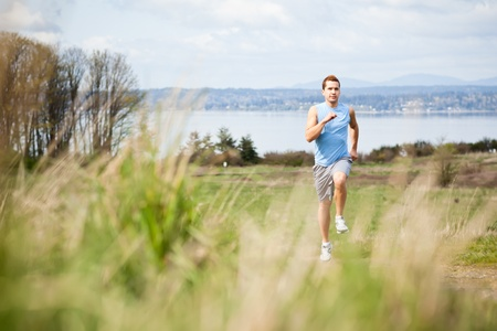 A shot of a mixed race man running outdoor photo