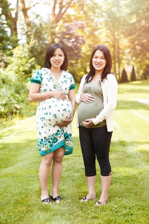 A shot of two beautiful pregnant Asian women Stock Photo - 10264737