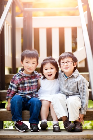 A shot of three cute little Asian kids smiling photo