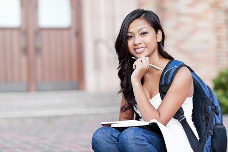 college building: A portrait of an Asian college student at campus Stock Photo