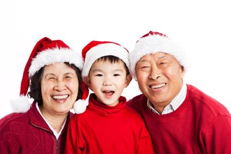 자신의 손자와 함께 크리스마스를 축하 아시아 조부모의 총