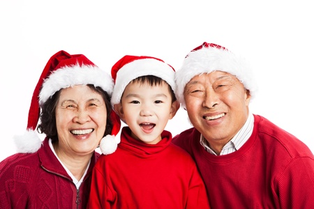 A shot of Asian grandparents celebrating Christmas with their grandson Stock Photo - 10876287