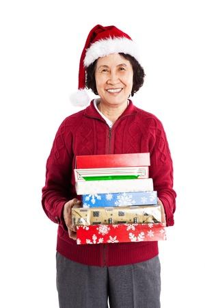크리스마스를 축하하는 수석 아시아 들고 크리스마스 선물의 총