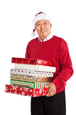 A shot of a senior Asian carrying Christmas presents celebrating Christmas photo