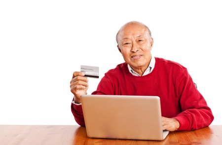 A shot of senior Asian man shopping online celebrating Christmas