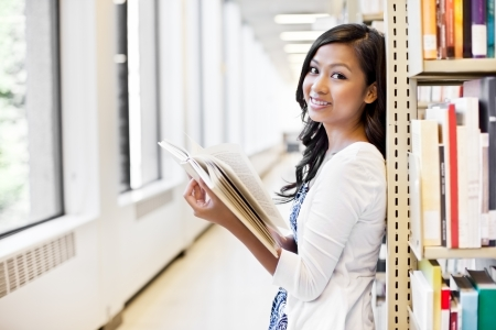 A portrait of an Asian college student in library photo