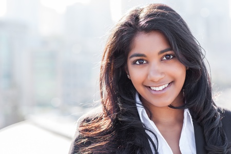 adult indian: A shot of a smiling confident Asian Indian businesswoman outdoor