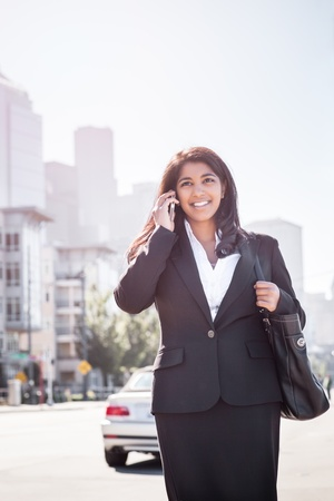 A shot of an Indian businesswoman talking on the phone  outdoor photo