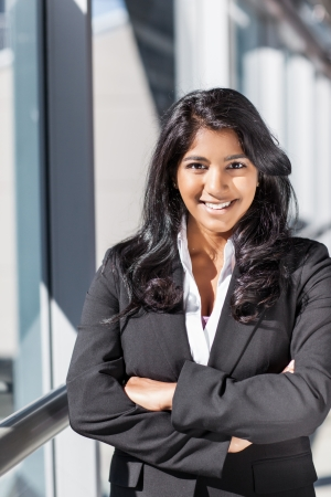 A shot of a smiling confident Asian Indian businesswoman outdoor photo