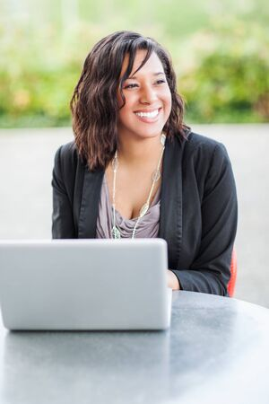 A shot of a happy African American businesswoman working on her laptop Reklamní fotografie